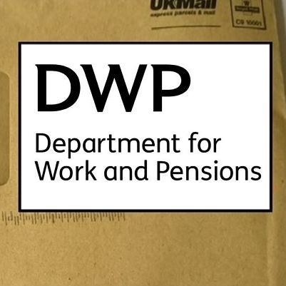 A ripped brown envelope and the DWP logo