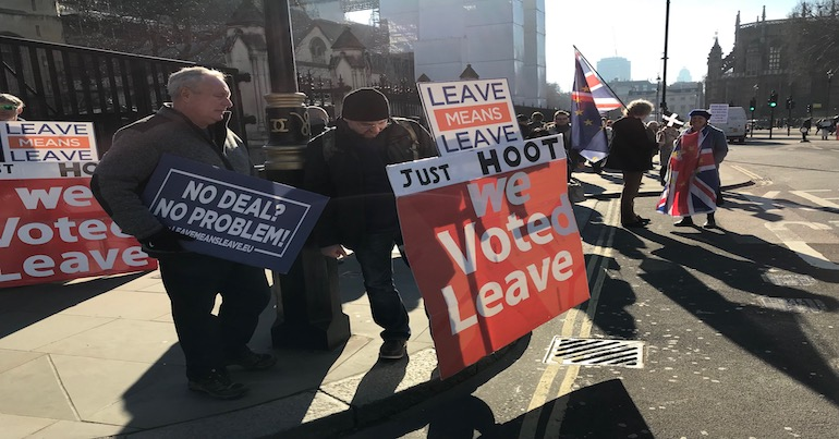 "Protestors in favour of a hard Brexit with signs saying ""No Deal? No Problem""."