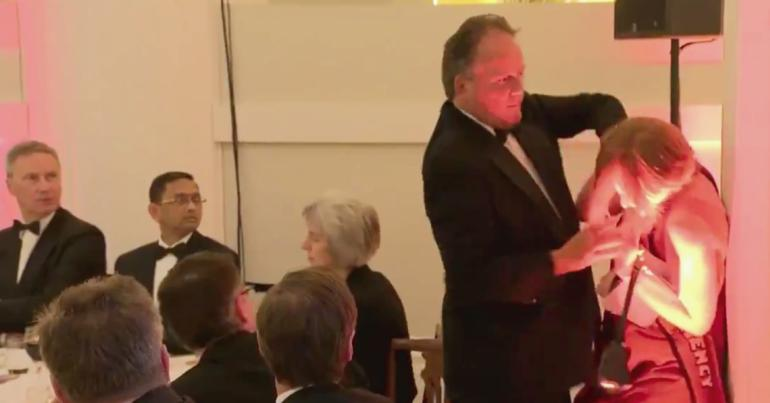 MP Mark Field pushing a woman against a pillar