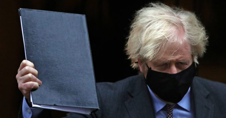 Boris Johnson in a black mask holding up a black folder